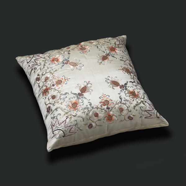25. Embroidered Pillow