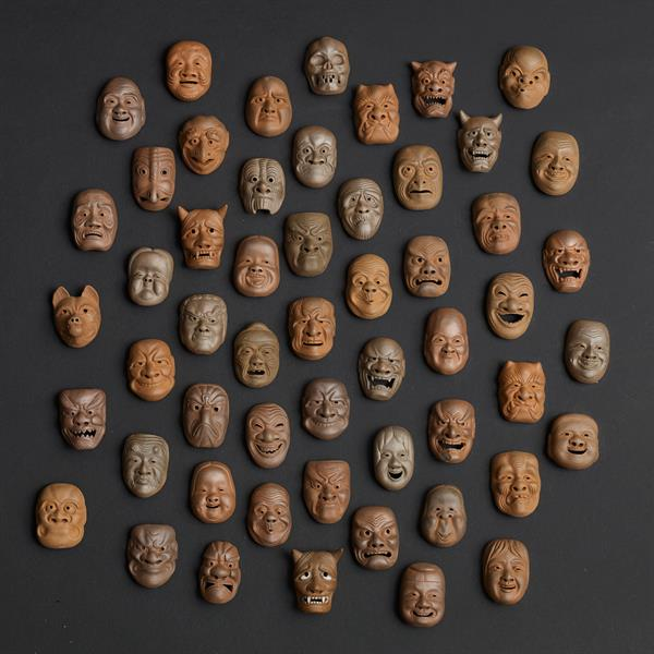 16. 54 Pottery Masks